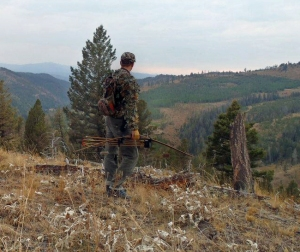 A bow hunter gazes out across a ridge. Photo by Samantha Katz, MSU Exponent