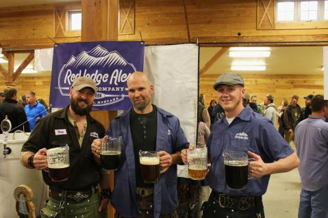 Members of the Red Lodge Brewing Company, dressed in kilts for the occasion, show off their wares. Photo by Brent Zundel