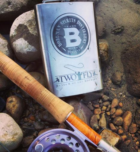 Fly rod and whiskey flask — the perfect Montana combination. Photo courtesy Bozeman Spirits Distillery