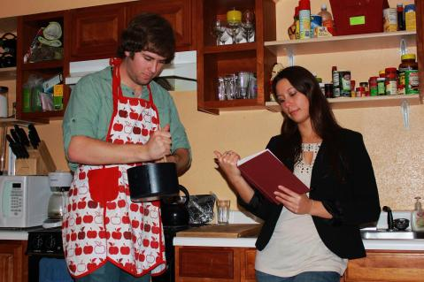Rhodes Scholar Amanda Frickle now wears the pants in the relationship; doting boyfriend Brent Zundel wears the aprons. Photo by Brent Zundel.