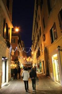 Narrow pedestrian pathways at night.