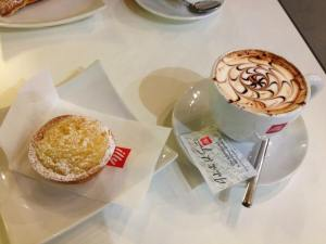 A typical breakfast: cappuccino and a rice pastry (surprisingly good).