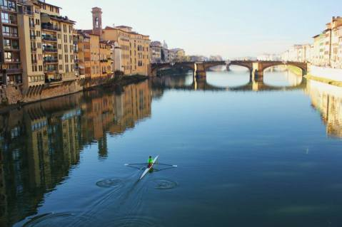 Wandering along the Ponte Vecchio, with a rower in the River Arno.