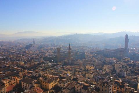 Looking out onto the city of Florence, with historic landmarks -- like the Palazzo Vecchio -- visible.