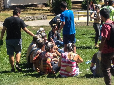 Freshmen being covered in flour, eggs, vinegar, mustard, and other non-traditional personal hygiene products.